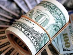 Índicadores fracos pressionam dólar para cima